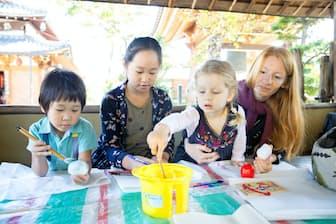 3月末に開催したイベントでは訪日客と地元の子供らが一緒に遊びを楽しんだ