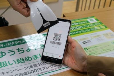 野村総合研究所は日本のキャッシュレス決済について、デビットカードの利用が伸びると予測する