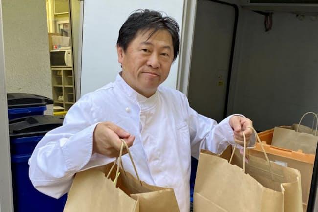 奥田シェフも自ら料理を宅配する