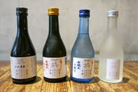 期間限定の酒販免許を取った東京・千代田の「北出食堂」では、飲食店応援のため特別に企画された日本酒・焼酎などを売る。左から福岡県・天盃の麦焼酎(800円)、岐阜県・岩村醸造「女城主」の純米酒(780円)と本醸造酒(600円)、新潟県・宝山酒造「宝山」の純米酒(715円)。価格はいずれも税別で飲食店での希望小売価格